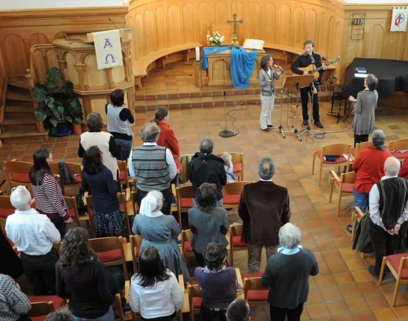 A photo showing people in a typical church service